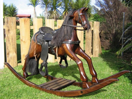 Large amber colored horse on bow rocker