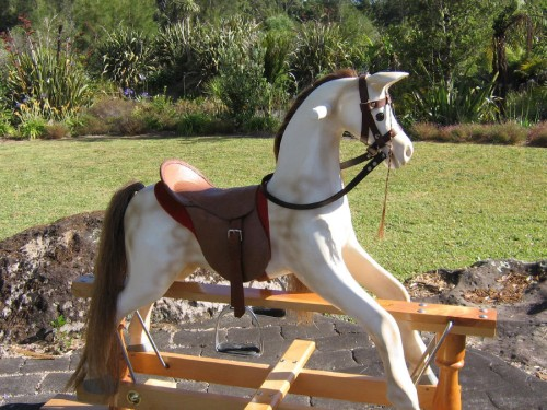 Medium rocking horse, brown on white dapple