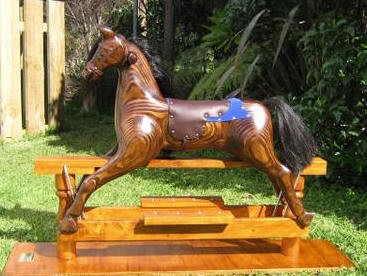 Small amber rocking horse on swing stand